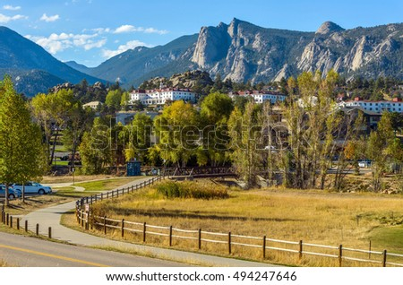 Estes Park - An autumn afternoon at Downtown Estes Park, with The Stanley Hotel and Rocky Mountains in background. Colorado, USA. Stock photo ©