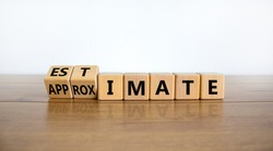 Estimate or approximate symbol. Turned wooden cubes and changed the word 'approximate' to 'estimate'. Beautiful wooden and white background, copy space. Business, estimate or approximate concept.