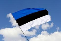 Estonia flag isolated on sky background with clipping path. close up waving flag of Estonia. flag symbols of Estonia.