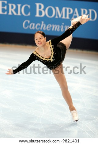 Estonia's Elena Glebova performs an arabesque spiral during the ladies short skating event in Bercy, Paris. This is Elena's season 2007/2008 short program.
