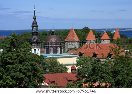 Estonia Tallinn Historical center panoramic view over rooftops with orthodox church and medieval red tiled watchtowers with Baltic sea in background