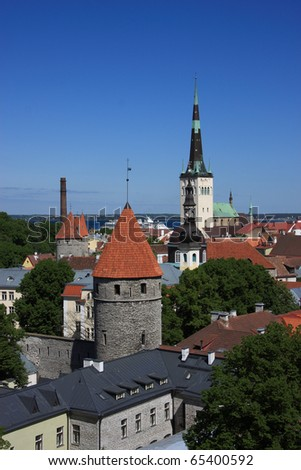 Estonia Tallinn Medievel Baltic city medieval towers and spire of Saint Olav Church viewed from high viewpoint