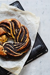 Estonian Kringle. Brioche with poppy and chocolate. Wreath. Baking, national pastries. Babka.