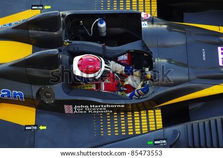 ESTORIL - SEPTEMBER 25: The FLM Oreca 09 of the Neil Garner Motorsport Team, stops in the pit-lane for refueling in the LMS race \