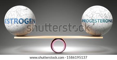 Estrogen and progesterone in balance - pictured as balanced balls on scale that symbolize harmony and equity between Estrogen and progesterone that is good and beneficial., 3d illustration Foto d'archivio ©