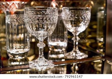 Etched crystal stemware in a luxury lit mirrored liquor cabinet #792961147