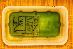 Etching of an electronic circuit in a ferric chloride solution