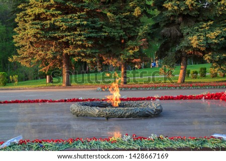 Eternal fire, a monument and flowers, a celebration of victory.Eternal fire memorial.