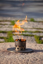 Eternal flame at President John F. Kennedy's grave site at Arlington National Cemetery in Northern Virginia