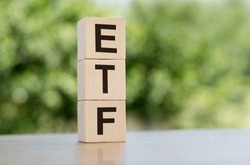ETF, Exchange Traded Fund, realtime mutual index fund that can trade in equity stock market, cube wooden block with alphabet building the word ETF