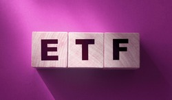 ETF, Exchange Traded Fund, realtime mutual index fund that can trade in equity stock market, cube wooden block with alphabet building the word ETF. Financial concept