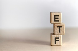 ETF - Exchange Traded Fund text on wooden cubes, on white background