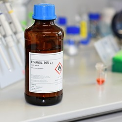Ethanol in the jar on the working surface in the laboratory. Alcohol. Spiri.