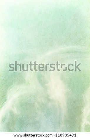 Ethereal and wispy clouds on a textured vintage paper background.  Image has a pleasing paper grain and texture visible at 100%.
