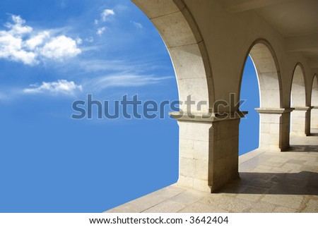 Ethereal image with marble arcades in a blue sky. - stock photo