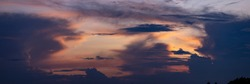 Ethereal panorama of painterly colorful cloudscape decor with radiant vibrant colorful magenta, yellow and orange sunset colors. Weather conditions and climate concept. Abstract background wallpaper.