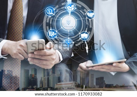 Ethereum and cryptocurrency investing concept - Businessman using mobile phone application to trade Ethereum ETH with another trader in modern graphic interface. Blockchain and financial technology. #1170933082