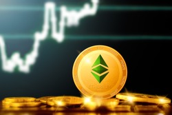 ETHEREUM classic (ETC) cryptocurrency; golden ethereum classic coin on the background of the chart
