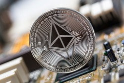 ethereum coin on an computer motherboard