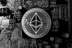 ethereum coin on an computer motherboard black and white