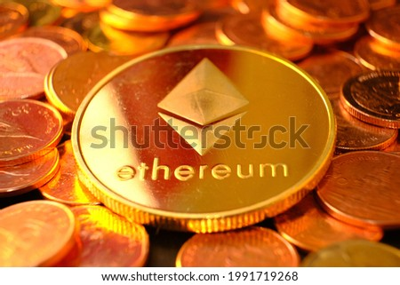 Ethereum cryptocurrency on table and digital currency money concept, crypto market, cryptocurrency financial systems concept, Gold coins background