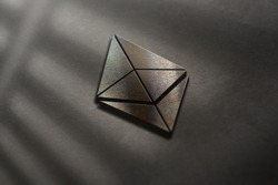 Ethereum cryptocurrency with rusted metal coin in middle of other crypto closeup