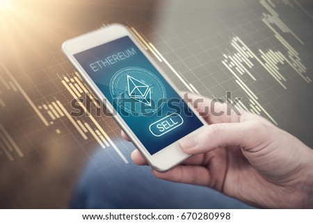 Ethereum crystal symbol on mobile app screen with SELL button. Ethereum decline and selling concept. New virtual currency