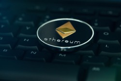Ethereum digital crypto currency coin on black computer keyboard
