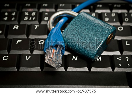 Ethernet cable on keyboard with a padlock as a metaphor for internet security, antivirus protection, firewalls and other data protection products.