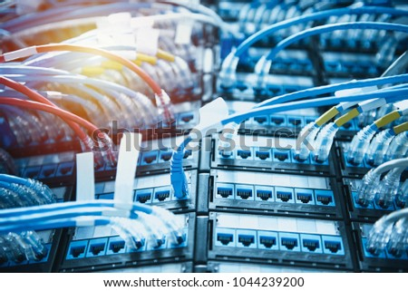 Ethernet cables connected on patch cord cable . Data center concept #1044239200
