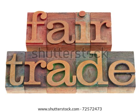 ethical business concept - fair trade words in vintage wood letterpress printing blocks, isolated on white