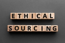Ethical sourcing - word from wooden blocks with letters, responsible and sustainable methods ethical sourcing concept, gray background
