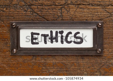 ethics tag - file cabinet label, bronze holder against grunge and scratched wood