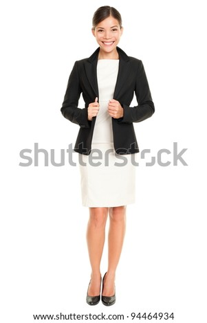 Ethnic Asian professional businesswoman standing confident in skirt suit isolated on white background.