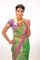ethnic beautiful Indian woman in studio background