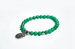 Ethnic bracelet with green malachite beads owl charm and silver 925 beads. Luxury jewellery for women for everyday or party