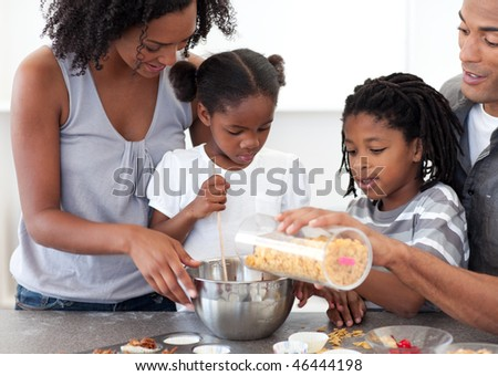 Ethnic family making biscuits together in the kitchen