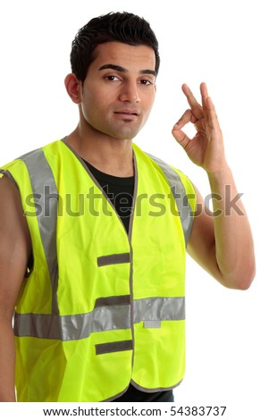 Ethnic mixed race, blue collar man such as a builder, tradesman, labourer, handyman gestures a positive a-ok approval hand sign gesture.  White background.