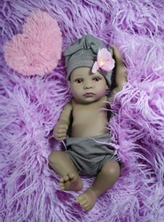 ethnic reborn baby doll in little brown dress