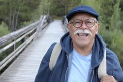 Ethnic senior man walking outdoors