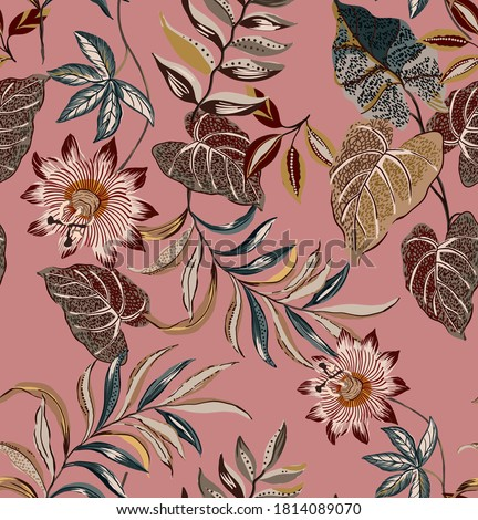 Ethnic tropical leaves seamless pattern fabric design textile wallpaper composed by ethnic flowers, vintage leaves and antique plants on pink background.