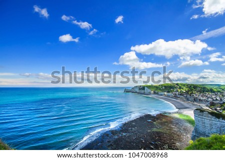 Etretat village and its bay beach, aerial view from cliff. Normandy, France, Europe. #1047008968