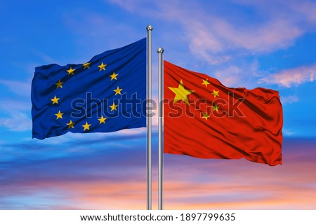 EU and Chinese flags against of blue sky