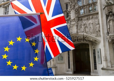 EU and Union Jack flags flying in front of The Supreme Court of the United Kingdom in the public Middlesex Guildhall building in Parliament Square in London