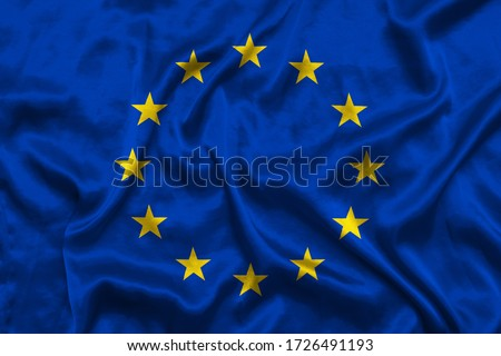 EU flag background with fabric texture. Flag waving in the wind. 3D illustration