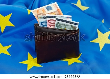 EU flag with wallet and money