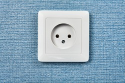 EU power outlet type C, electric point of power at home, on the blue background.