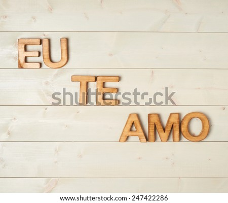 Eu Te Amo meaning I Love You in Portuguese written with the block letters over the wooden background Stockfoto ©