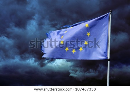 EU torn flag in stormy sky