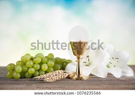 Eucharist, sacrament of communion background #1076235566